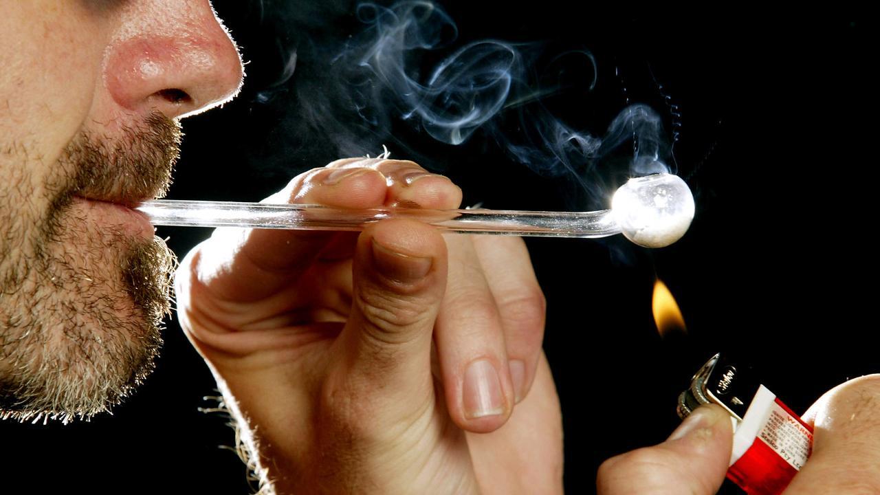 Man smoking crack drug through glass pipe 21 Dec 2003. use drugs /Narcotic/drugs