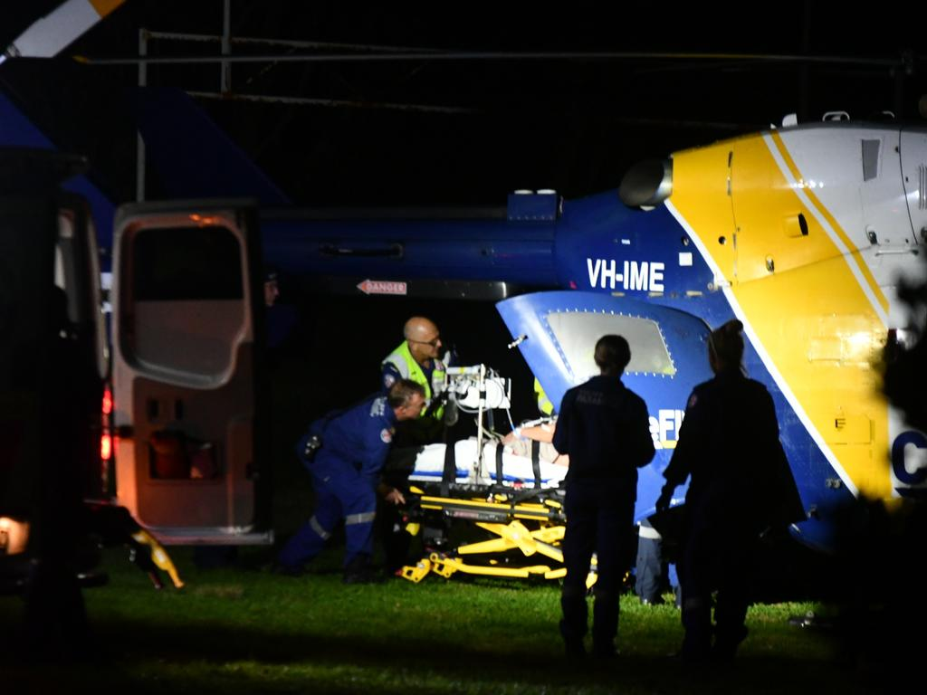 The man injured by the speargun is loaded aboard the CareFlight rescue helicopter at Avalon. Picture: Sebastien Dekker
