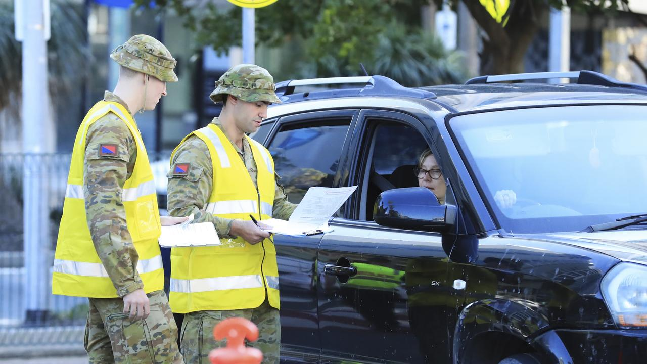 Australian Defence Force personnel assist Queensland Police at the Griffith St, Coolangatta checkpoint. Picture: SCOTT POWICK.