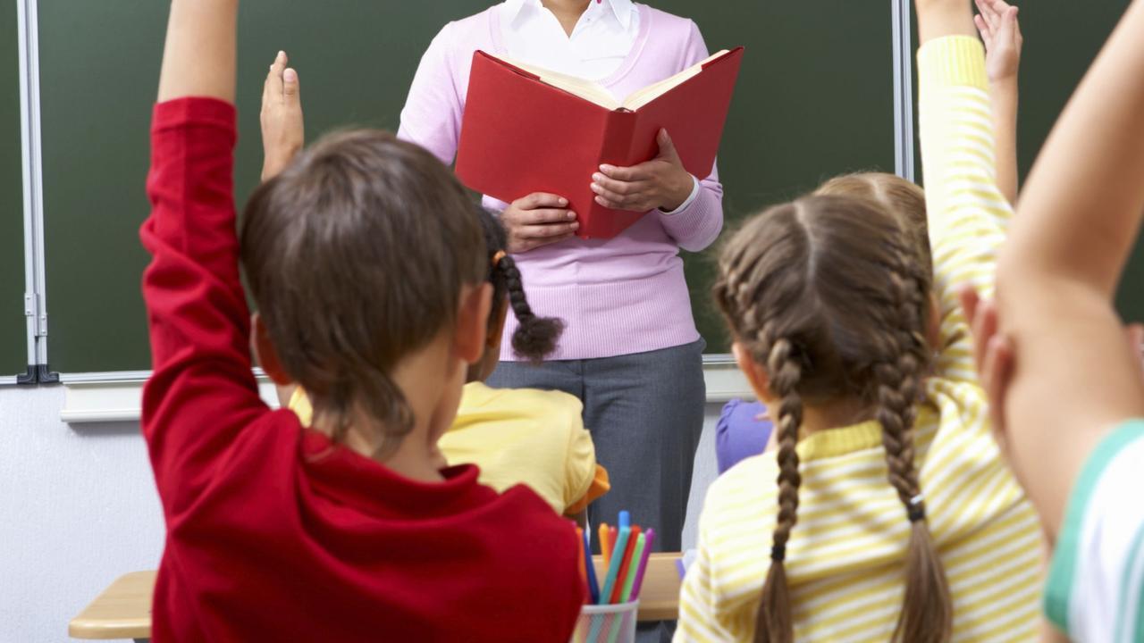 Generic image of teacher teaching students inside school classroom.