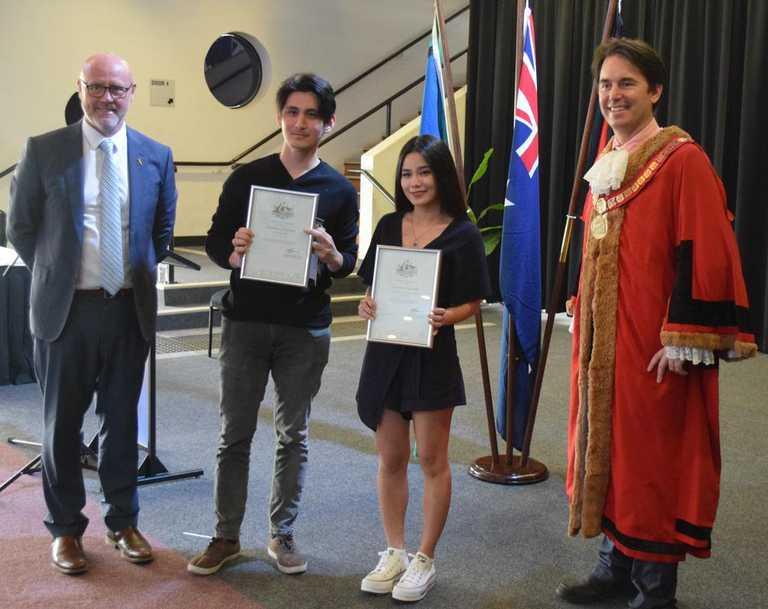 CITIZENSHIP: Alexson Dela Cruz and sister Alexandra receive their citizenship certificates from Fraser Coast Mayor George Seymour and Deputy Mayor Darren Everard. Photo: Stuart Fast