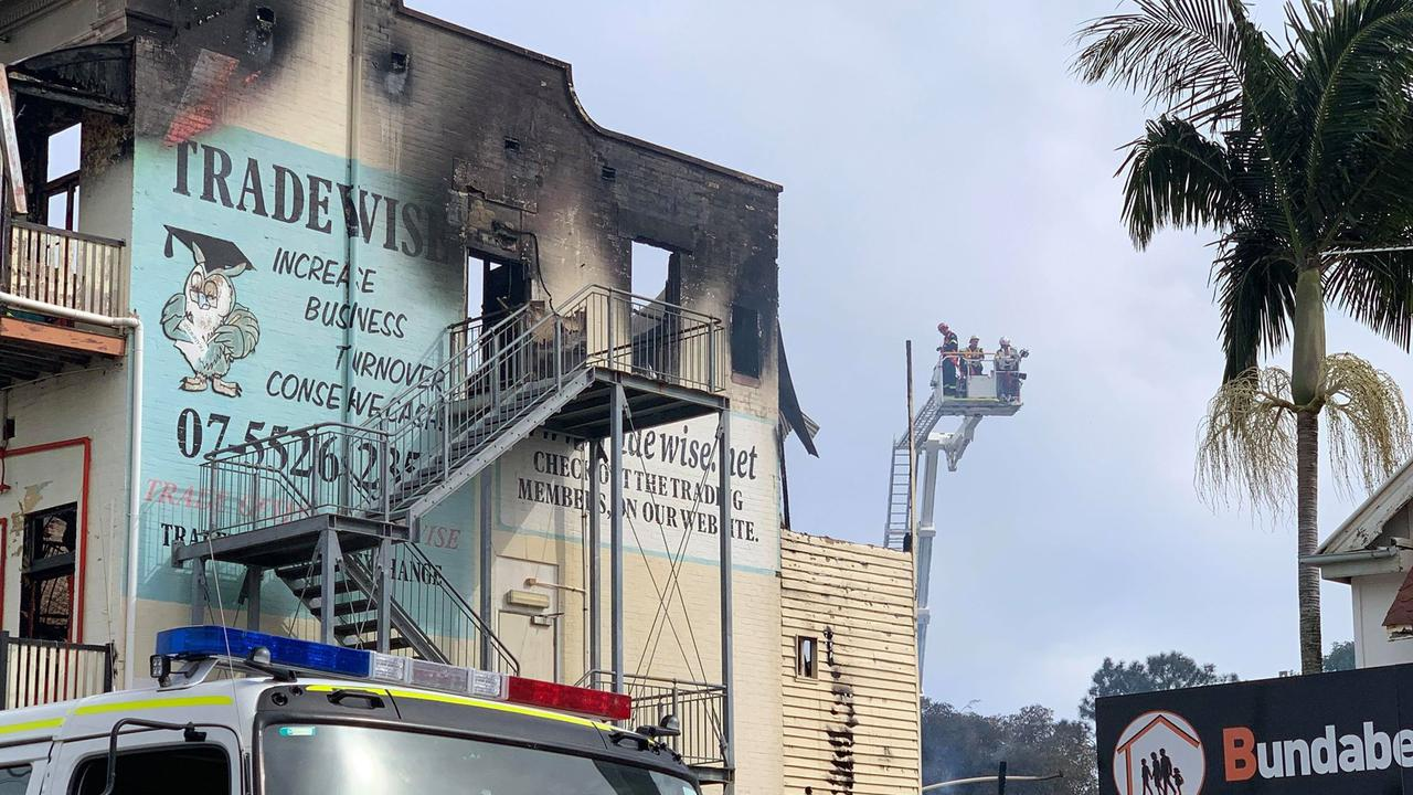 SAFETY CONCERNS: Firefighters remain on the scene after a blaze destroyed the Federal Backpackers. Photo: Mikayla Haupt.