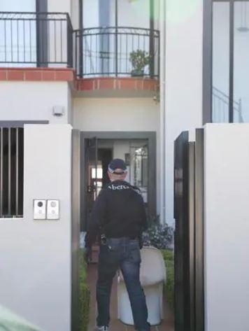 Police raid the Earlwood property. Picture: John Grainger