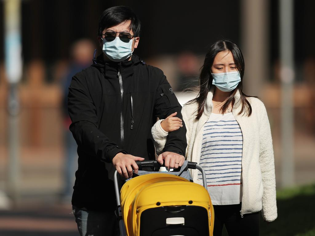 A couple staying safe in Sydney amid new outbreaks. Picture: Getty Images