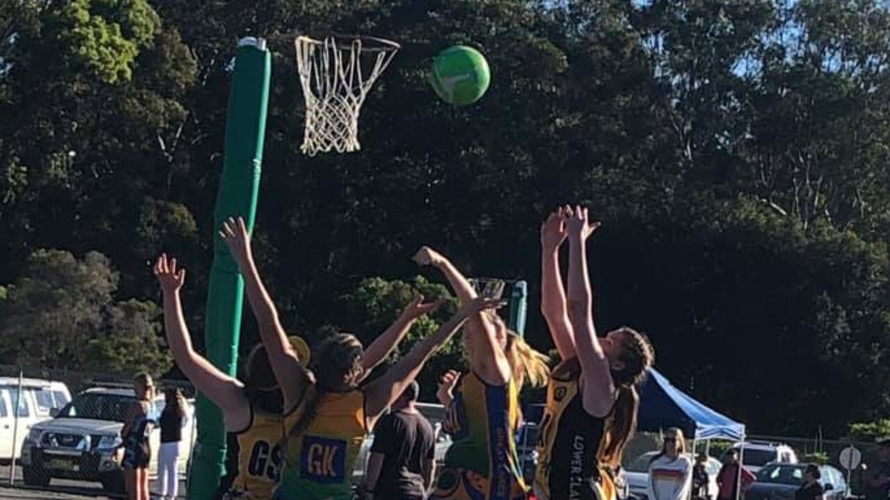 Lower Clarence Netball Association representative side in action at the carnival in Woolgoolga on Sunday.