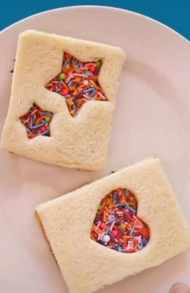 It doesn't end there – he doesn't cut it up in triangles. Instead, he uses a cookie cutter to form love heart and star shaped cut-outs in another change to the original – a sandwich lid. Picture: TikTok/Lunchboxdad