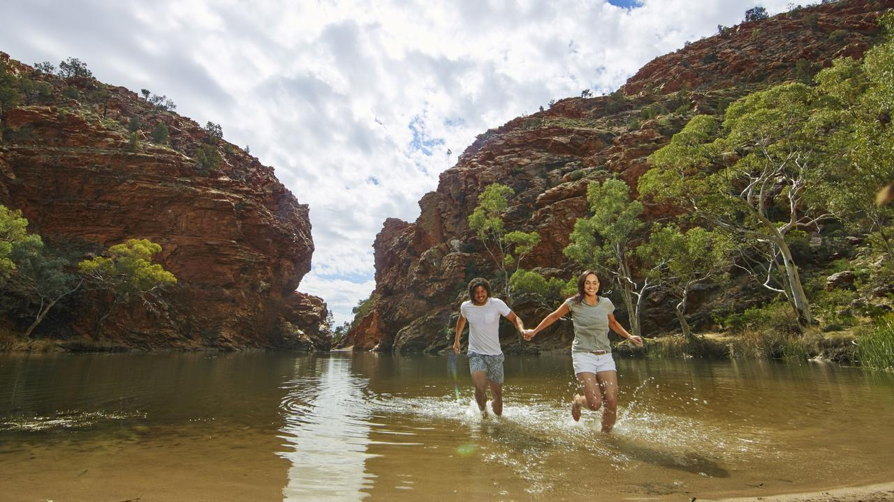 Tourists at Ellery Creek Big Hole in Tjoritja/ West MacDonnell National Park, 161km west of Alice Springs. NT tourism industry figures say it is time for Territorians to step up and use their $200 vouchers. Picture: Tourism Central Australia