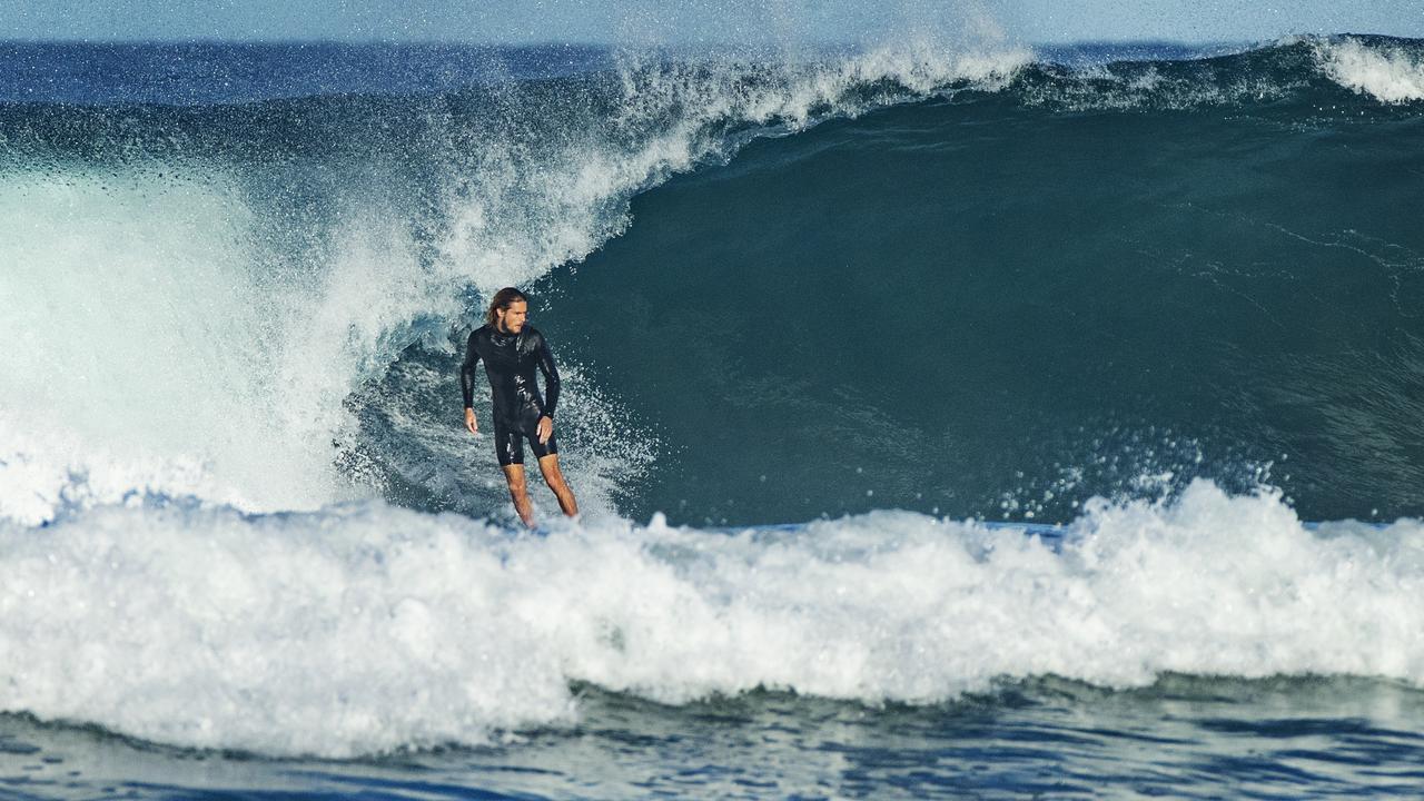 A surfer in action at Sunrise Beach. Photo: Lachie Millard