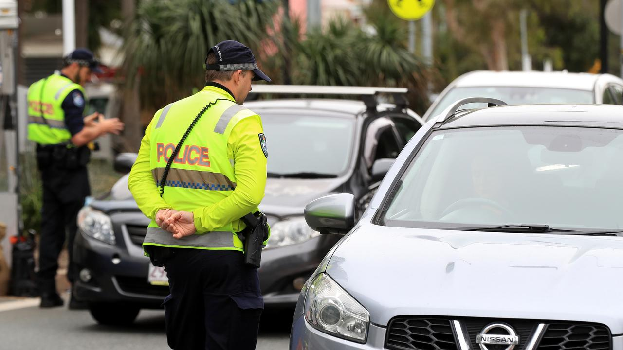 Police speak to drivers at a Coolangatta checkpoint. Picture: Adam Head