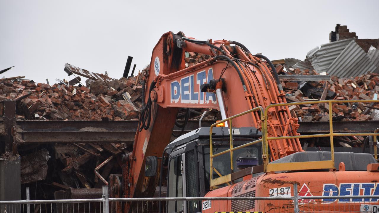 The Federal Backpackers building continues to be torn down on July 23, 2020, after it was destroyed by flames on Monday night and Tuesday morning.