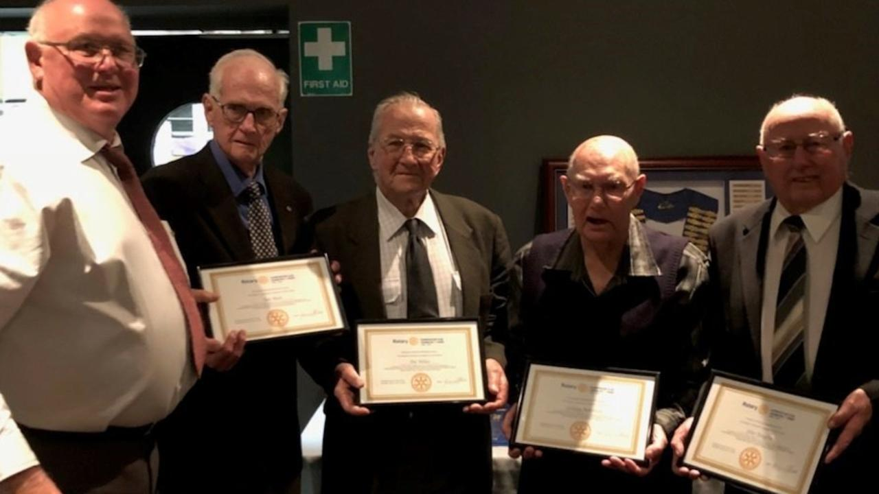 Rotary President Graeme Moore (left) presents awards for outstanding service to Bill Bishop (62 years) Pat Nolan (51 years) Lindsay Robertson (51 years) and John Roughley (47 years) as part of the Club's 70 year celebration.
