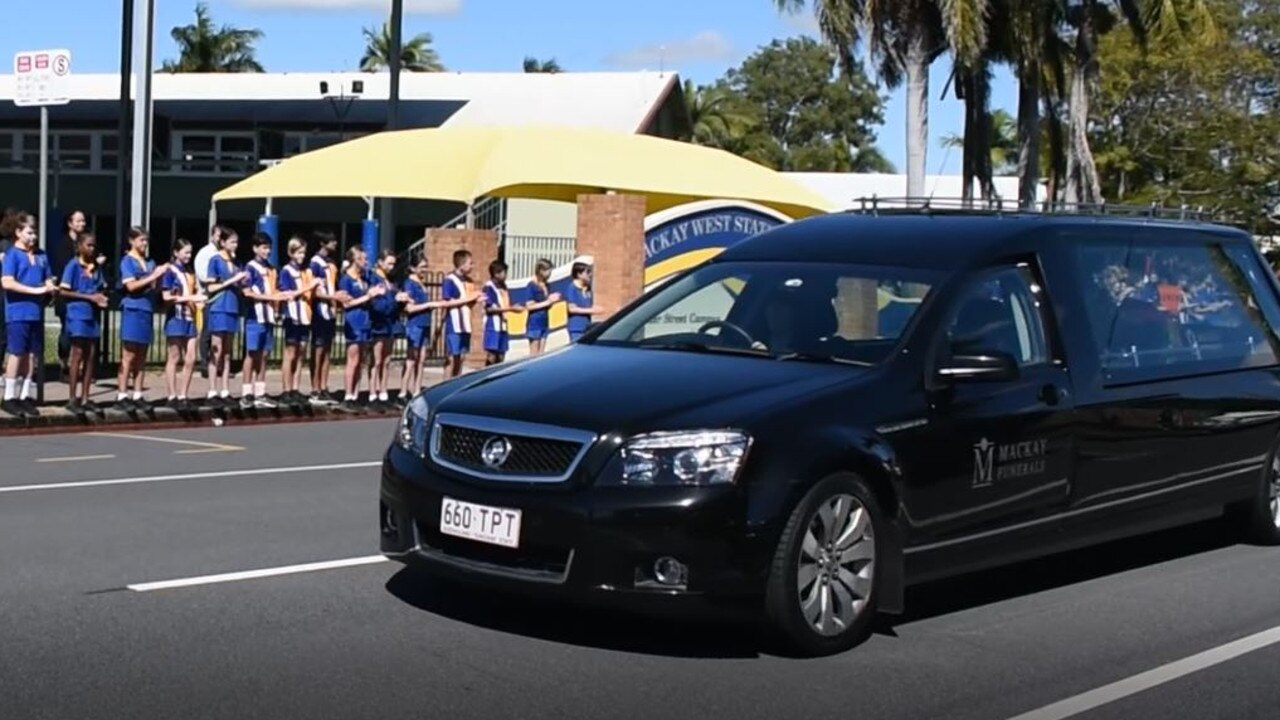 Mackay West State School students for a guard of honour for Ray Breckenridge, the school crossing guard who greeted them each morning and afternoon for 33 years.