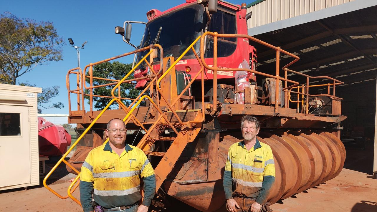 McCoskers Contractors employees with the $1 million Gladstone designed engineered and constructed buoyant scrolling machine used to extend mining tailings dam walls. Picture: Rodney Stevens