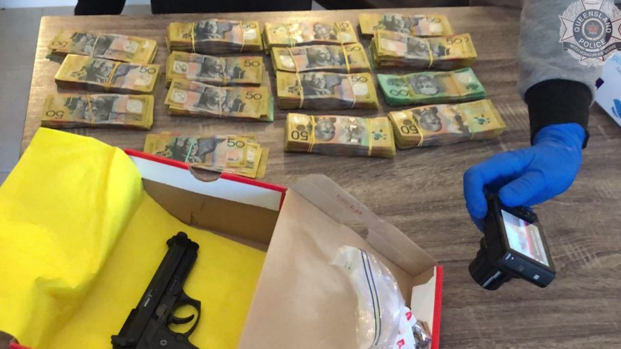 More than $40,000 and firearms were seized during the raid of a Gold Coast residence.