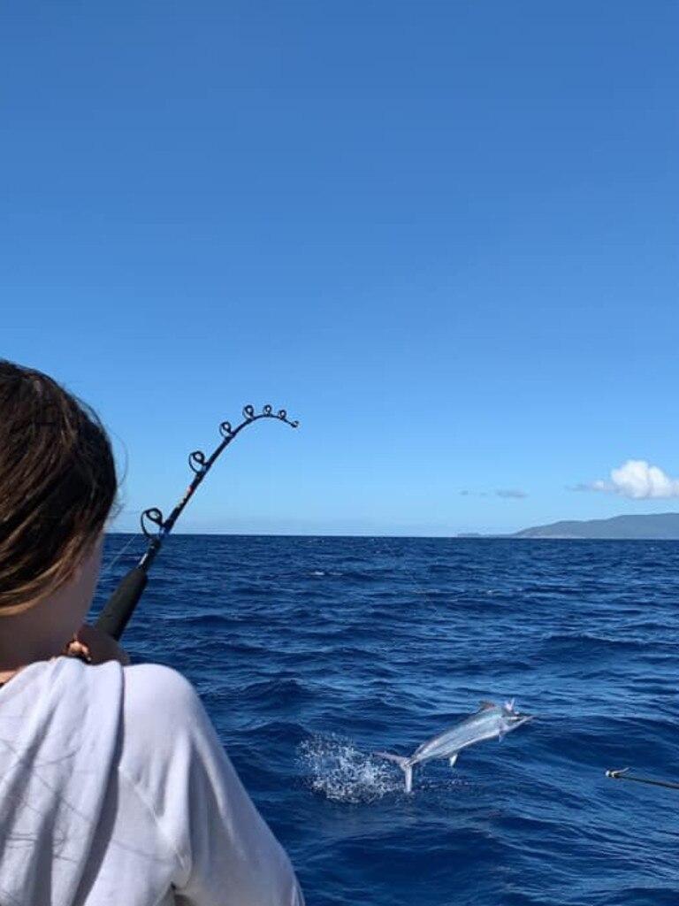 Townsville juniors catch a marlin.