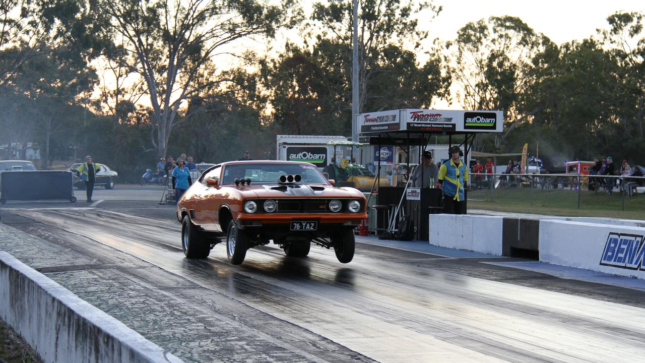 Gladstone's Brett Kelly gets the front wheels off the ground in his Ford Falcon coupe on the way to a low 10 second pass at Benaraby Dragway. Picture: Rodney Stevens