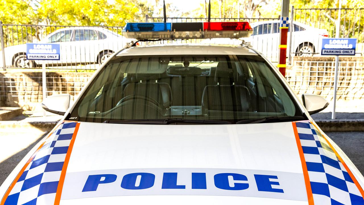 BAILED UP: Police caught a drunk man intentionally damaging their vehicle after a night out. (AAP Image/Richard Walker)