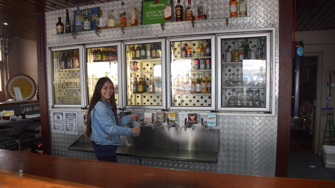 Tash Calderley will be pouring less drinks than usual at the Kingaroy Hotel this weekend thanks to new coronavirus measures. (Picture: Tristan Evert)