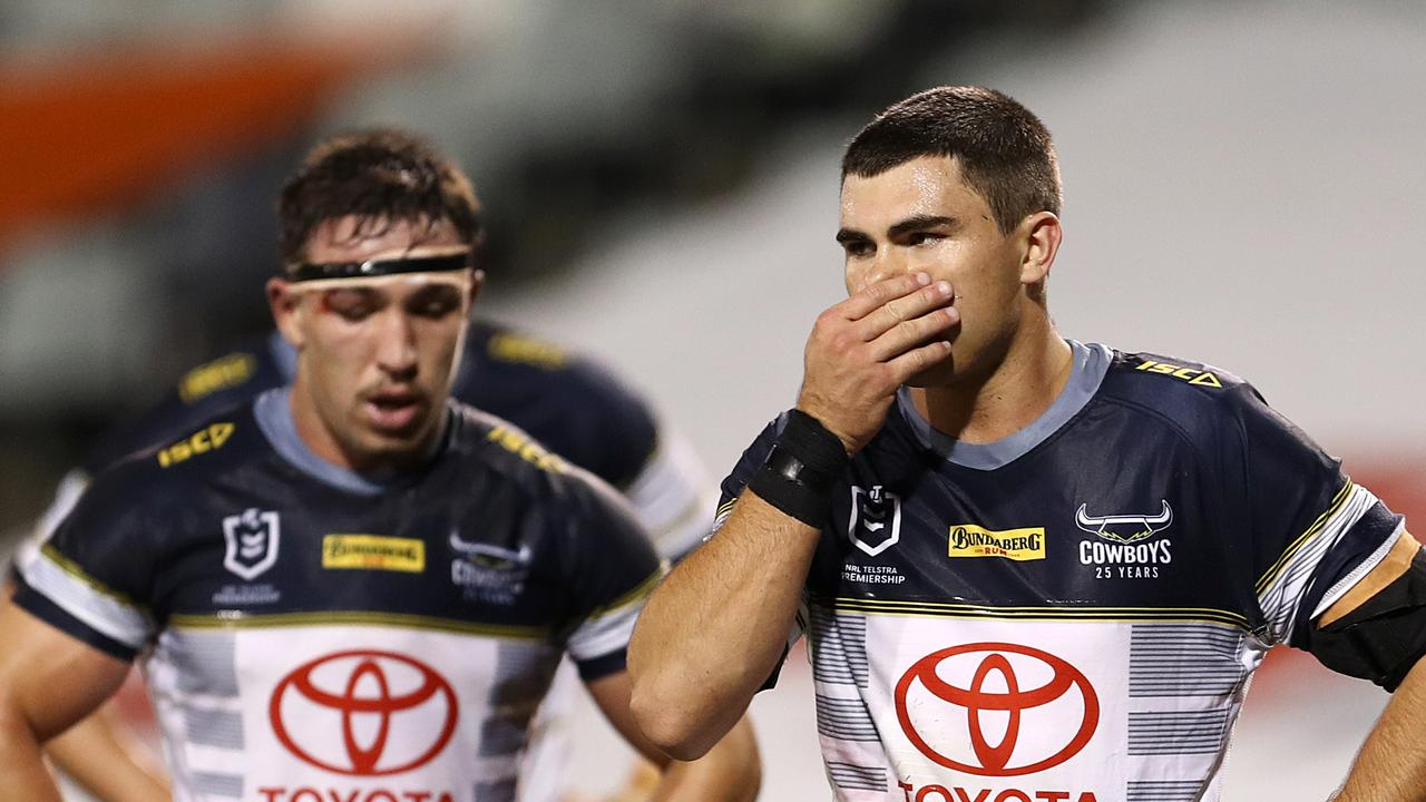 Jake Clifford of the Cowboys (right) reacts following a Tigers try during the Round 6 NRL match between the Wests Tigers and the North Queensland Cowboys at Campbelltown Stadium in Sydney, Saturday, June 20, 2020. (AAP Image/Brendon Thorne) NO ARCHIVING, EDITORIAL USE ONLY