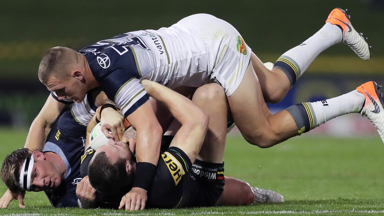 Isaah Yeo of the Panthers is tackled by Josh McGuire and Coen Hess of the Cowboys during the round 10 NRL clash at Panthers Stadium. (Photo by Matt King/Getty Images)