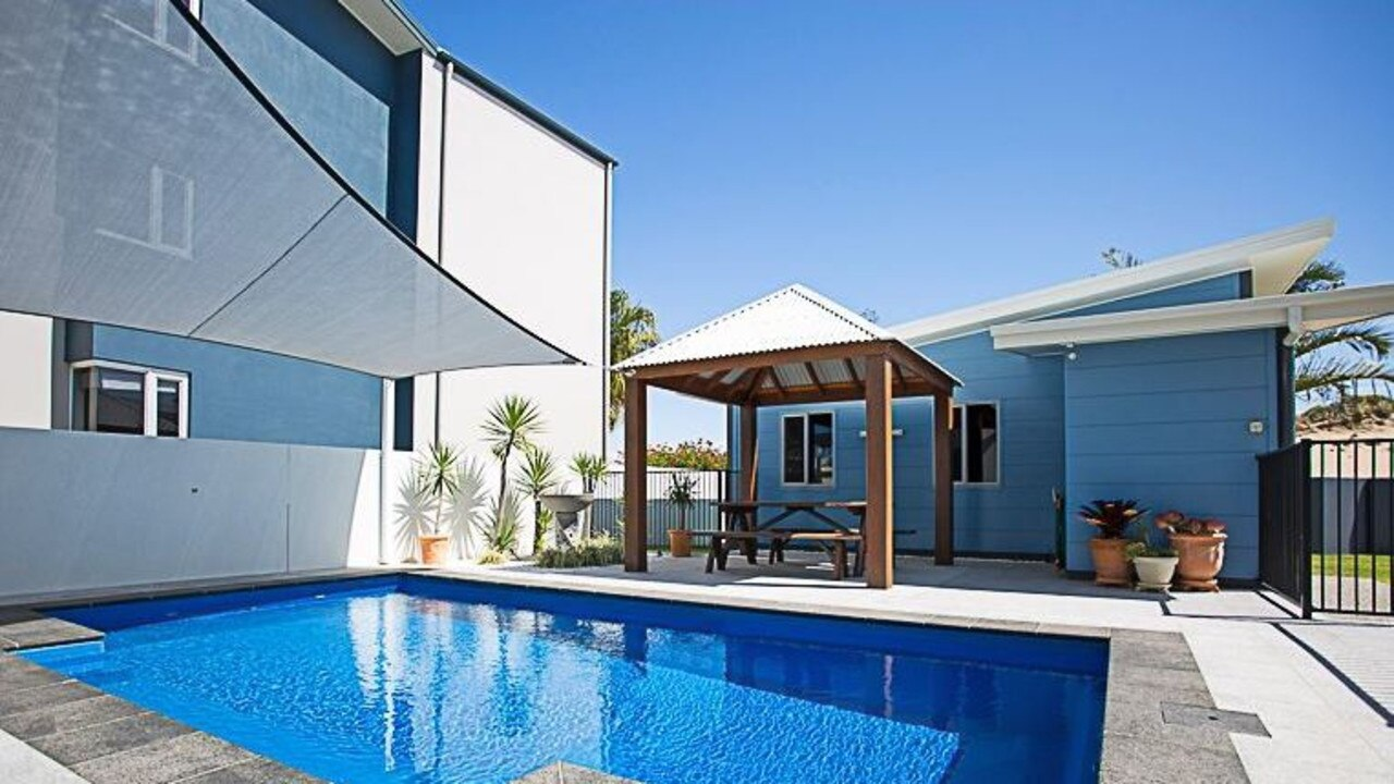 This private home is a gated complex is just footsteps from the beach at Mackay Harbour. 24/19 East Point Drive is now on the market. Picture: realestate.com.au