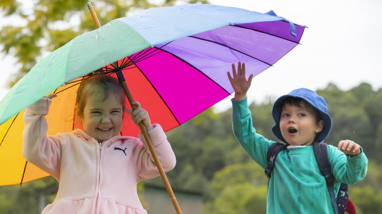 RAINY DAYS: Banjo Cruz 3, and Grace Robb 2, play in the rain at Ninderry. Photo Lachie Millard
