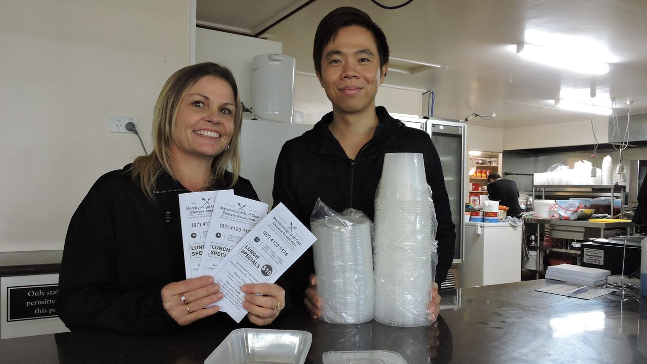 Manager Amanda McCracken and caterer Eric Guan at the Maryborough Golf Club, celebrating the opening of its new Chinese restaurant.