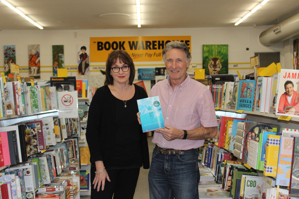Image for sale: The Book Warehouse owner Julie Holgate with underwater photographer Mark Spencer.
