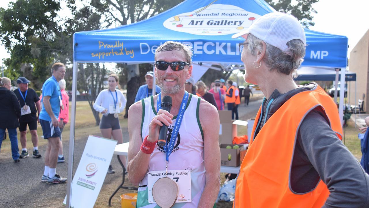 Marathon winner Adrian Royce with Wondai Running Festival committee member Ros Heit. (Picture: Tristan Evert)