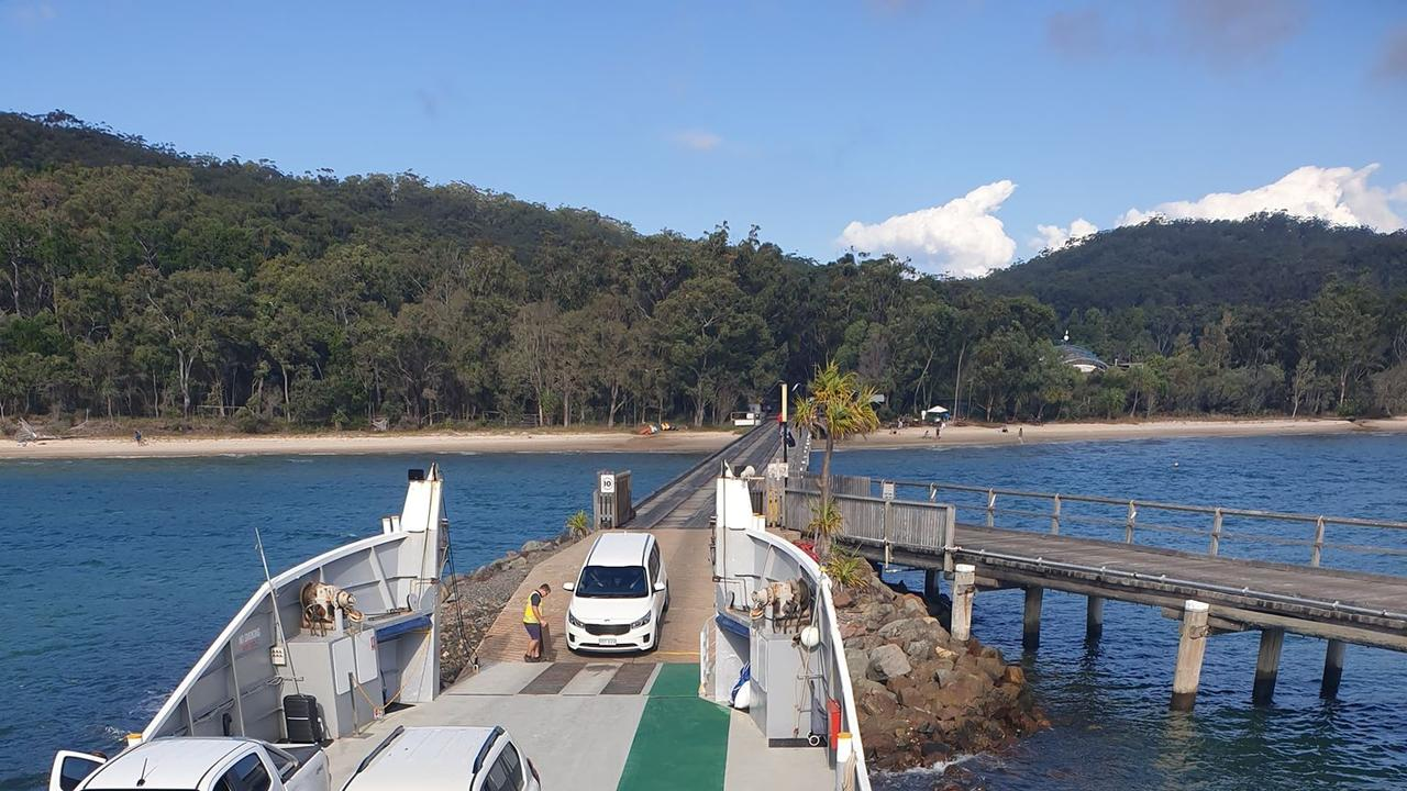 The funeral car driving onto the barge at Fraser Island.