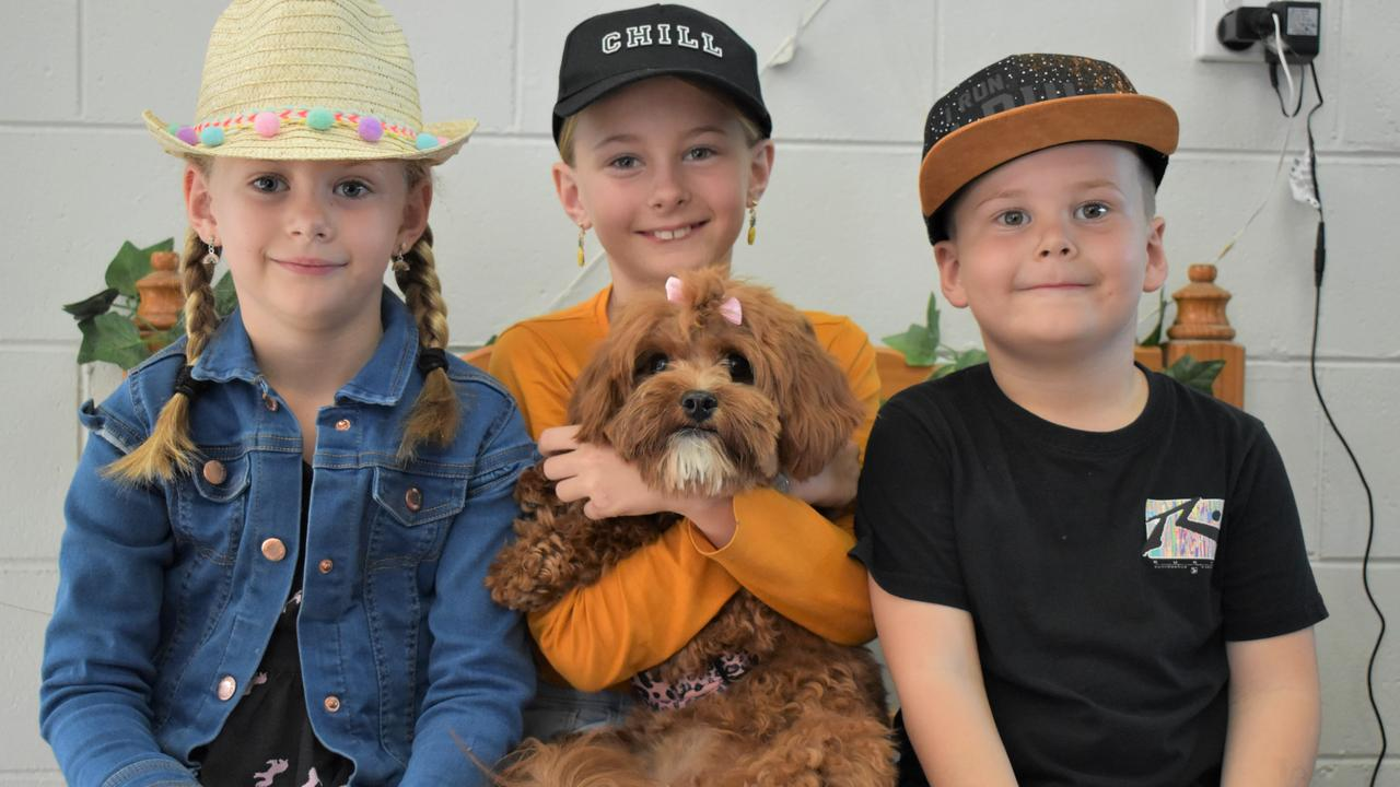 Brooklyn McDonald, 6, Ruby McDonald, 8, and Jaxon McDonald, 4, with their cavoodle Sunny, at the opening party of Purrrfection Puppy Preschool and Dog Daycare on Evans Ave in North Mackay. Picture: Heidi Petith