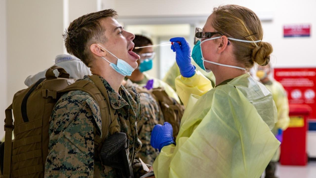 A US Marine part of the final wave arrives at RAAF Base Darwin and undergoes COVID-19 testing on Friday, before being transported to his quarantine quarters. Picture: Sarah Marshall