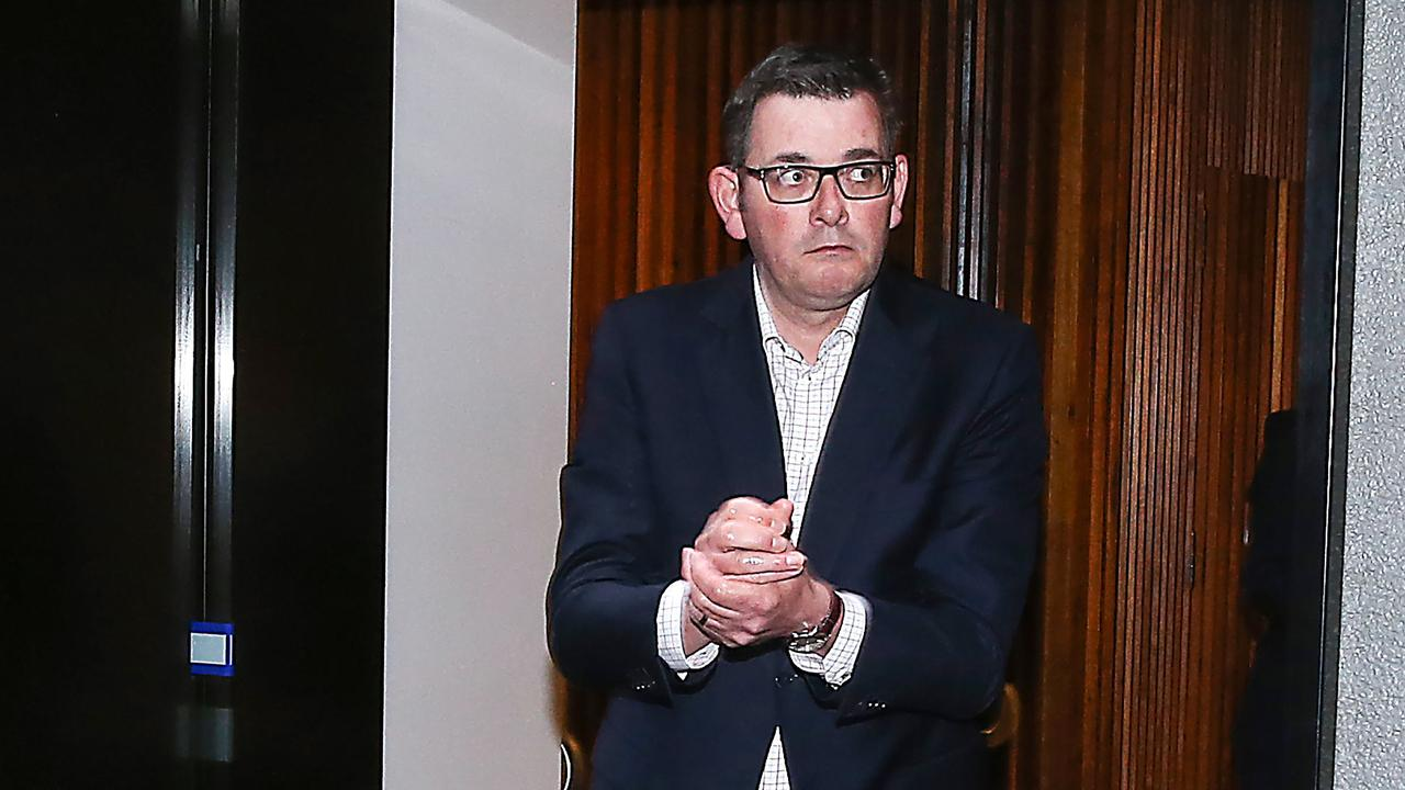 Victorian Premier Dan Andrews wipes his hands with sanitiser after announcing the lockdown of Metropolitan Melbourne and Mitchell Shire for 6 weeks due to a spike in the cases of the coronavirus. Picture : NCA NewsWire / Ian Currie