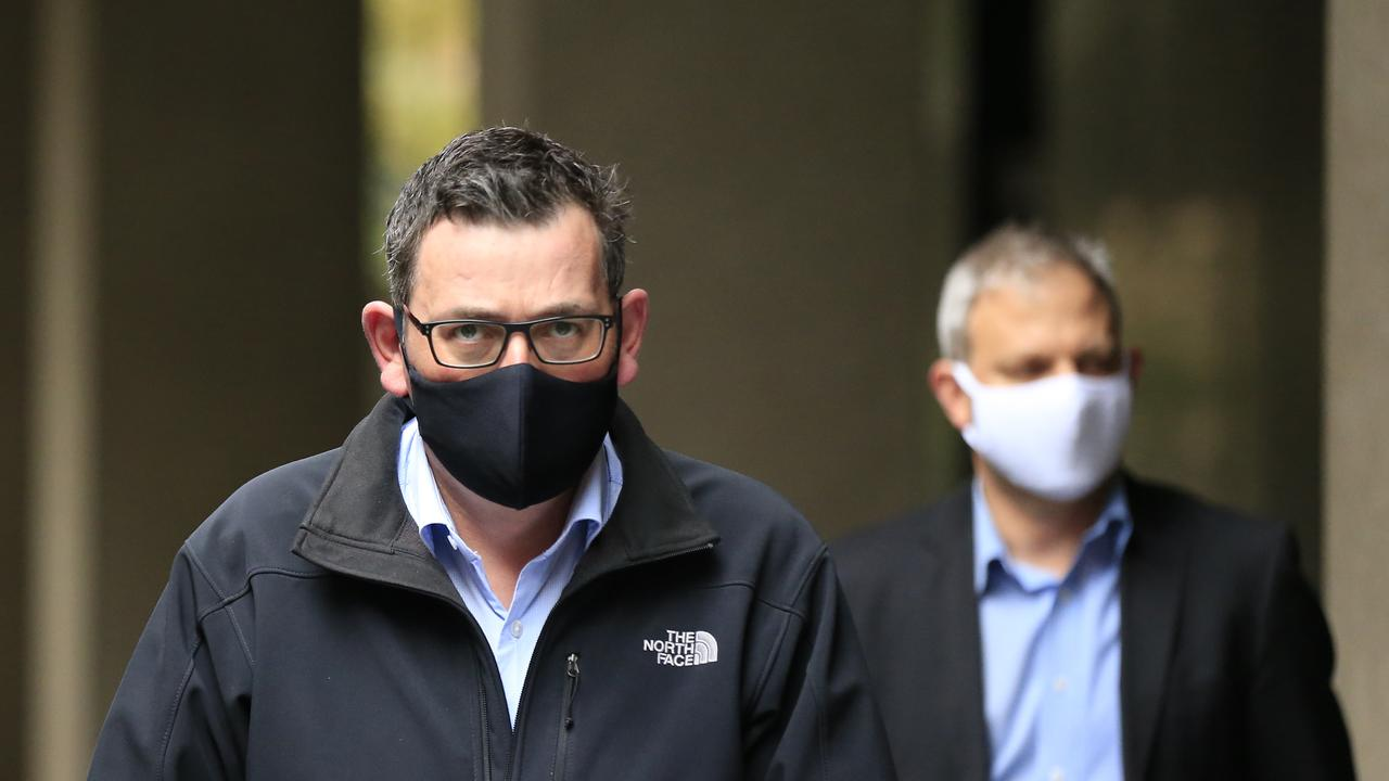 Premier Daniel Andrews and Chief Health Officer Brett Sutton arrive for another daily briefing. Picture: Getty