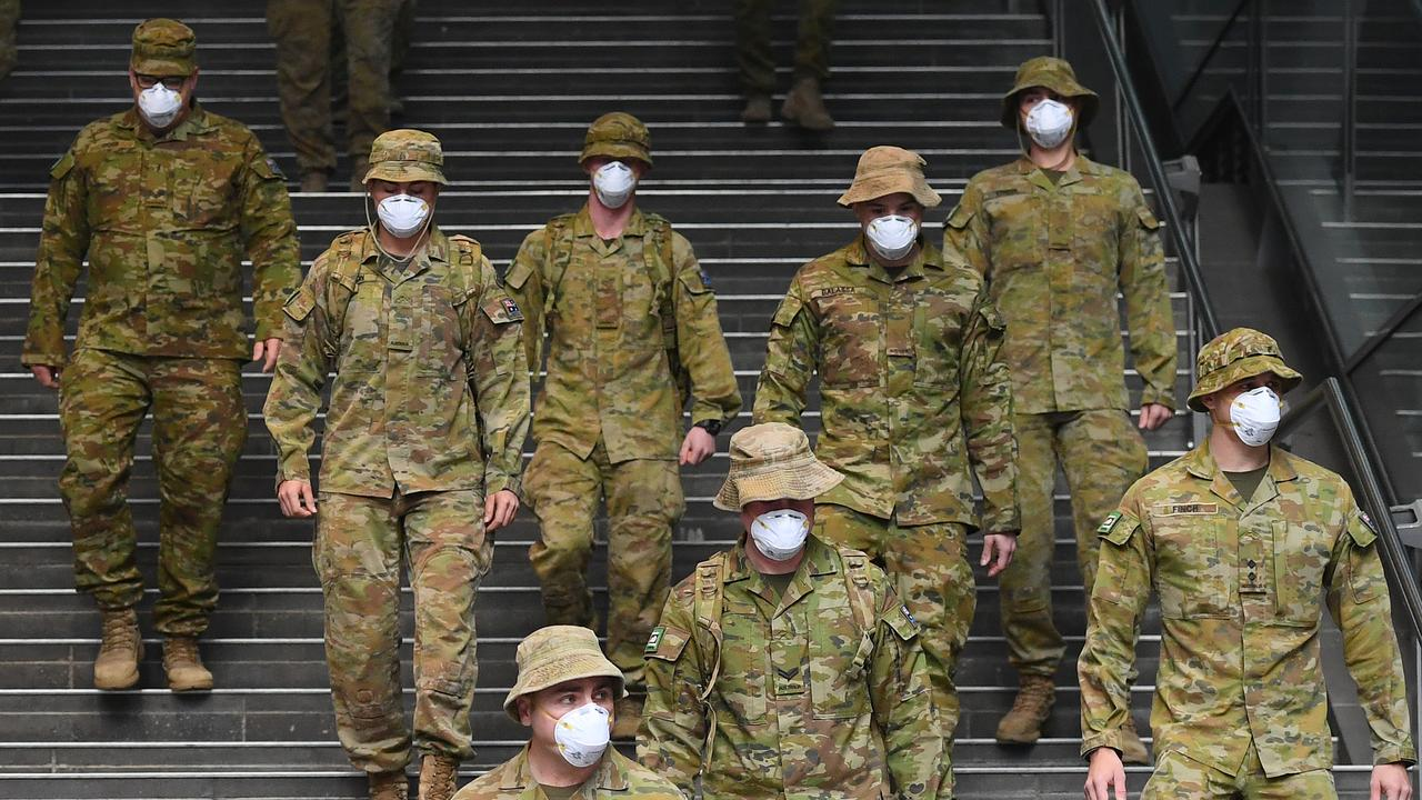 Members of the Australian Defence Force walk through Melbourne. Picture: Quinn Rooney/Getty Images