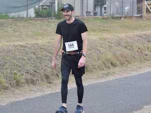 Injured marathon runner walks 8km to cross finish line