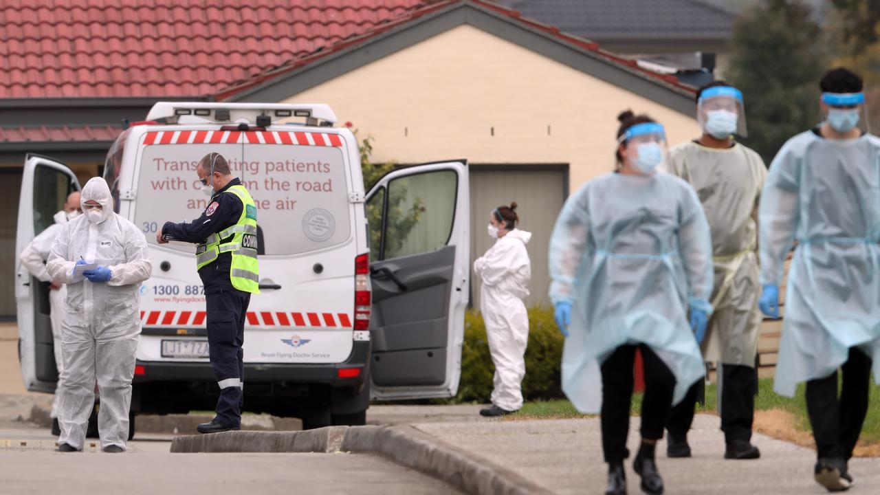 Aged care residents in Fawkner are taken to waiting ambulances after a COVID-19 outbreak. There are fears Victoria's death toll will rise sharply this week. Picture: David Crosling