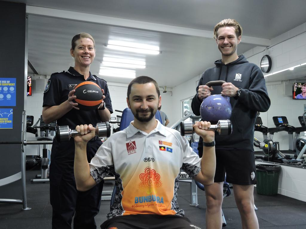 Acting Sergeant Leigh Nancarrow with Mark Staib and Jackson Dunn at Hervey Bay PCYC gym.