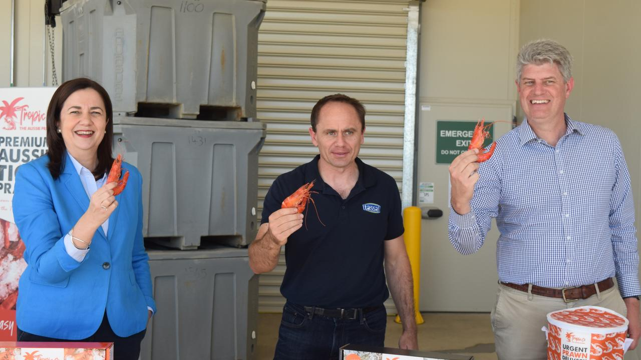 Premier Annastacia Palaszczuk with Tassal Group's Head of Supply Chain and Commercial Services Ben Daley and Local Government Minister Stirling Hinchcliffe at the Tassal farm at Gregory River today.