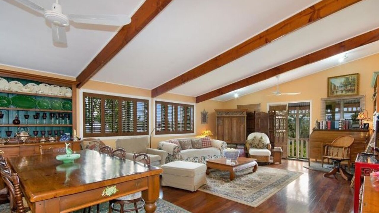 It feaures expansive living and dining areas.