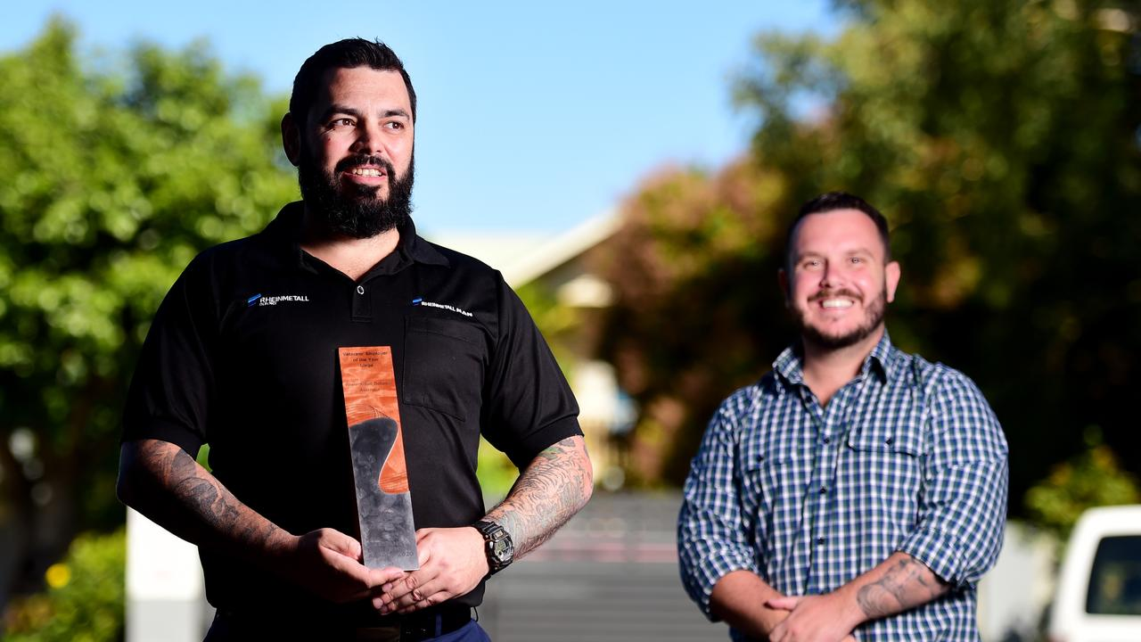 Member for Herbert Phillip Thompson presented Army Veteran and Veterans' Project Manager at Rheinmetall Defence Australia Paul Warren with the Prime Minister's Veterans' Employer of the Year Award. Picture: Alix Sweeney