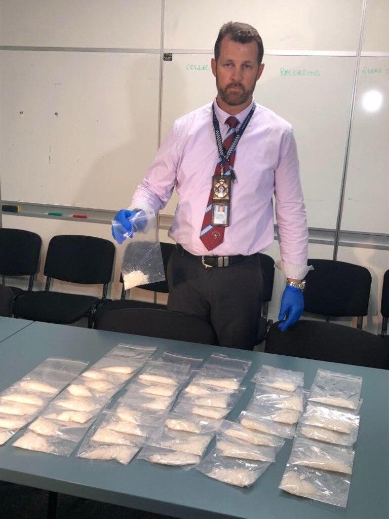 Detective Senior Sergeant Luke Peachey with the 1.2 kilos of ice.
