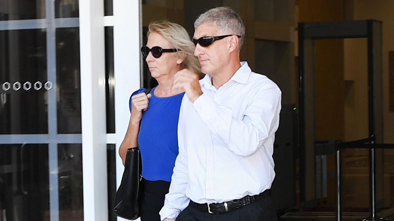 Former NT Police Assistant Commissioner Peter Bravos with wife Cindy Bravos outside the Supreme Court after pleading not guilty to two counts of rape.