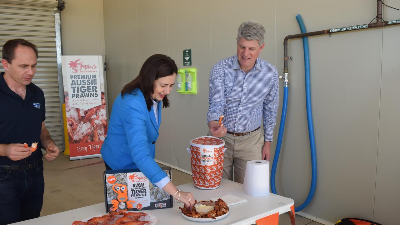 Premier Annastacia Palaszczuk samples some fresh prawns.