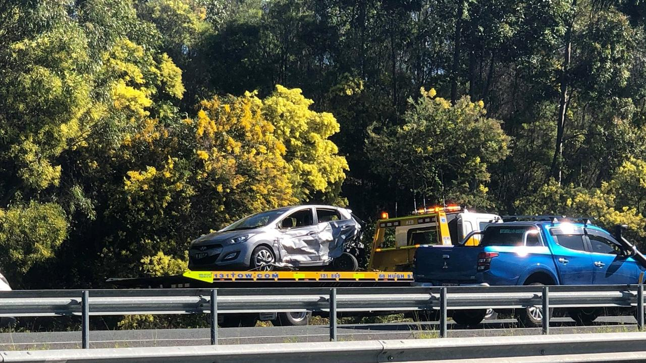 Police work to clear the scene of a three-car crash on the Centenary Hwy at Carole Park on Tuesday morning.