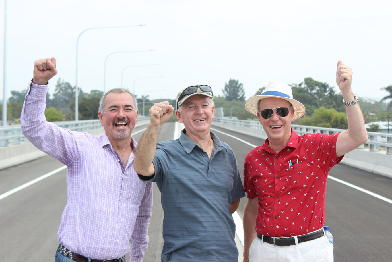 Chris Gulaptis, Ron Bell and Des Harvey celebrate at the new Grafton bridge opening on 12/12/19.