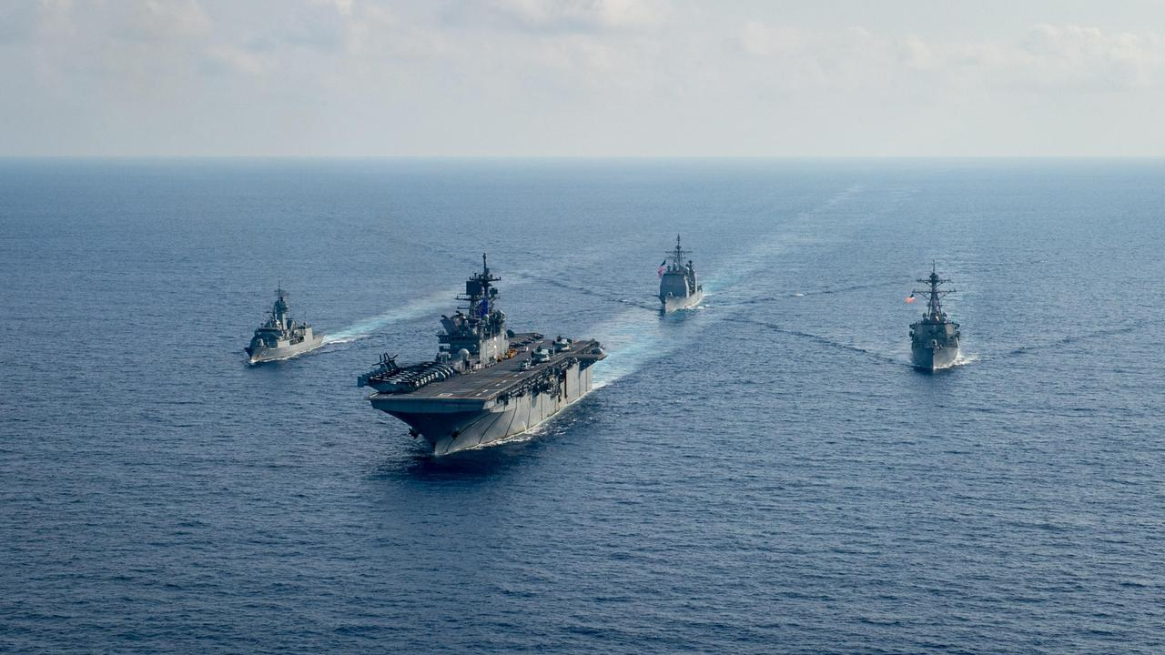 (L-R) Royal Australian Navy helicopter frigate HMAS Parramatta conducts officer of the watch manoeuvres with amphibious assault ship USS America, guided-missile cruiser USS Bunker Hill and guided-missile destroyer USS Barry in the South China Sea. Picture: Department of Defence