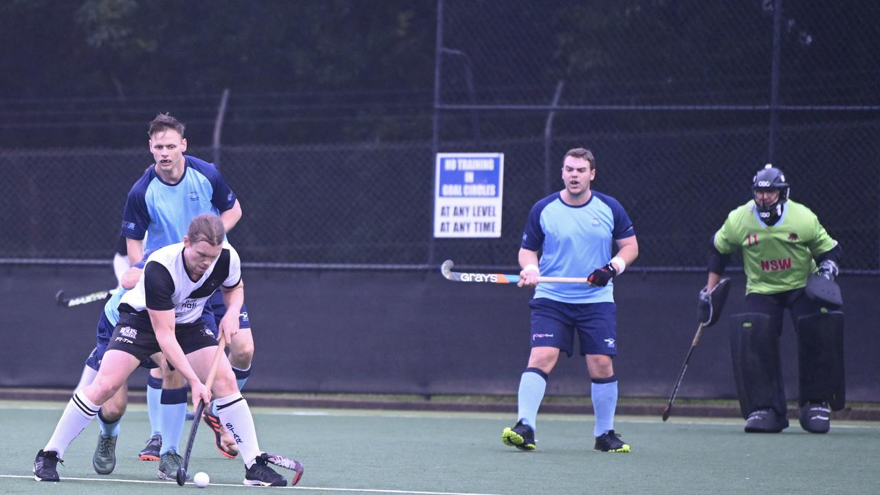 HOCKEY MEN: AM Northern Star's Ryan McGuiness setting up an opportunity to score against Ballina. Photo: Shez Napper