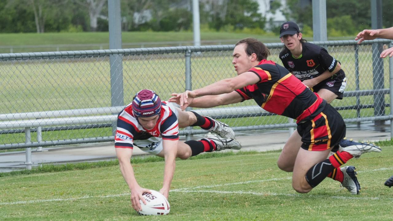 St Patrick's College player Brady Hazeldine touches down in the corner for a try in St Pat's big 40-6 win over The Rockhampton Grammar School.