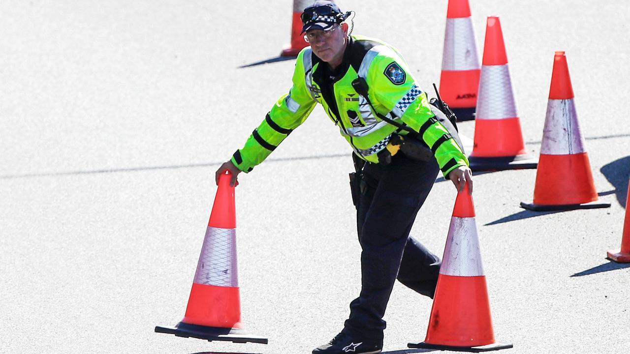 Queensland police divert traffic on the Queensland/NSW border. Picture: Nigel Hallett